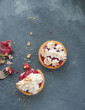 Shortbread tart with raspberry curd and meringue. Sand tarts with raspberry curd, chili and merengue on a concrete background Stock Photo