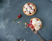 Shortbread tart with raspberry curd and meringue Royalty Free Stock Photography