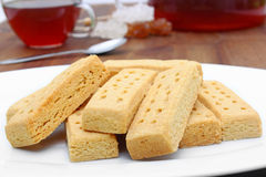 Shortbread and tea. Tasty shortbread fingers with black tea Royalty Free Stock Image