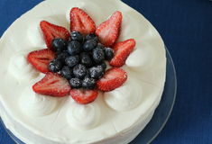Shortcake. With strawberries and blueberries on top Stock Image