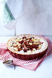 Shortcrust plum tart with coconut crumble Royalty Free Stock Photos
