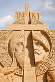 Shortlived sculpture from sand. Cross and Sword Stock Photos