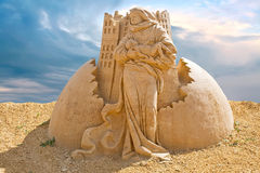 Shortlived sculpture from sand. Freedom Royalty Free Stock Photos