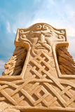 Shortlived sculpture from sand. Hammer of Thor Royalty Free Stock Images
