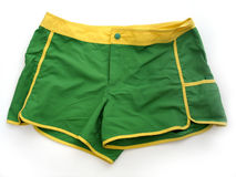 Shorts. A pair of green/yellow shorts stock image