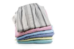 Shorts. Pile of stripped boxer shorts (male underwear) isolated on white background Royalty Free Stock Photography