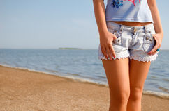Shorts and beach. Girl with shorts on the beach Royalty Free Stock Photos