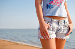 Shorts and beach. Girl with shorts and beach behind royalty free stock photos