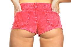 Shorts di colore rosa caldo della donna Fotografie Stock