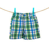 Shorts hanging on the clothesline on white background Royalty Free Stock Images