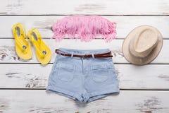 Shorts, hat and fringe bra. stock photos