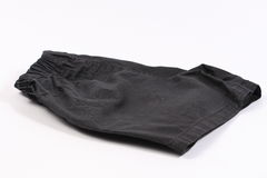 Shorts noirs d'isolement sur le blanc Photographie stock