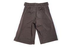 Shorts per il bambino su bianco Fotografia Stock