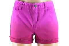 Shorts pourpres de jeans de femmes. Image libre de droits