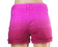 Shorts pourpres de jeans de femmes. Photographie stock libre de droits