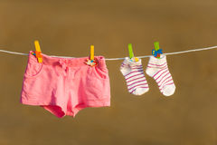 Shorts and socks are drying on a line with Stock Images