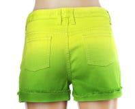 Shorts verts de jeans de femmes. Images libres de droits
