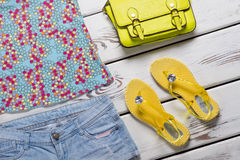 Shorts and yellow flip flops. Royalty Free Stock Photo