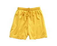 Shorts Yellow. Yellow shorts isolated on white background in a studio-photo stock photo