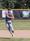 Shortstop Makes the Play. A Foothill High School shortstop making a play against Pleasant Valley during a baseball game in Redding, California Stock Image