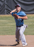 Shortstop. A Pleasant ValleySchool shortstop making a play against Foothill during a baseball game in Redding, California Stock Image