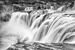 Shoshone Falls, Idaho. Shoshone Falls in Twin Falls, Idaho is considered to be the Niagara Falls of the West.  With water falling a staggering 212ft to the Snake Stock Photo