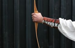 After the shot. Medieval Archer shooting arrows at targets Royalty Free Stock Images