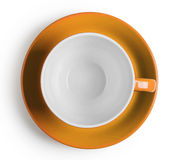 Shot from above orange cup with saucer Royalty Free Stock Images