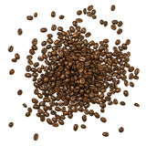 Shot from above pile of coffee beans. Shot from above handful pile of the roasted coffee beans isolated over white background Royalty Free Stock Photos
