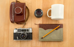 Shot from above of retro journalist equipment lying on wooden ta Stock Photos