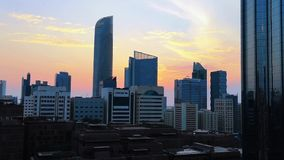 Shot of Abu Dhabi city famous towers world trade center at a beautiful magical sunset.  stock video