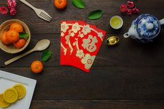 Shot of accessories Chinese new year & decoration Lunar festival concept. Background.beautiful arrangement essential items on modern rustic brown wood at home Stock Photo