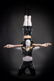 Shot of acrobatic stunt performed by go-go dancers Royalty Free Stock Image