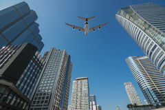 Shot of airplane flying above skyscrapers in City of Bangkok dow Royalty Free Stock Photography