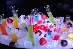 closeup of ice bucket with shot and fruit juice test tubes and cocktail   royalty free stock photo