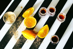 Shot alcoholic cocktail. Jagermeister alcoholic cocktail drinks on a board with orange Royalty Free Stock Photography