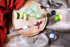 Shot alcoholic cocktail. Mexican alcoholic drinks shot on a wooden board. Good tequila booze with decor composition and barman. Different layers of vodka Royalty Free Stock Photography
