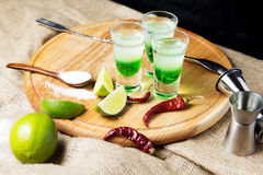 Shot alcoholic cocktail. Mexican alcoholic drinks shot on a wooden board. Good tequila booze with decor composition and barman. Different layers of vodka Stock Photography