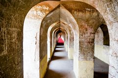 Shot of an arched hallway of an ancient building. Shot of an old and cracking arched hallway. Shot in the famed Labyrinth of the bara imambara in lucknow uttar Royalty Free Stock Photos