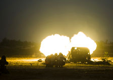 Shot of artillery fire with flash Royalty Free Stock Image