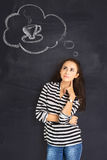 A shot of attractive young woman standing in front of blackboard Stock Photography
