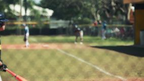Shot of a batter ignoring a ball and then the catcher throwing it back to pitcher during a baseball game. stock footage