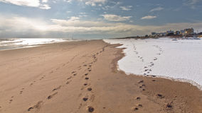 Footprints In The Sand And Snow Stock Photography