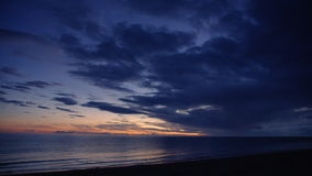 Shot of beach on dawn daylight. A wide shot of a beach panning shot to the right stock video