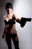 Shot of a beautiful girl holding gun Royalty Free Stock Image