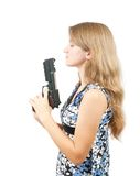 Shot of a beautiful girl holding gun over white Royalty Free Stock Photos