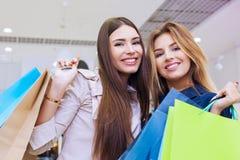 Shot of a beautiful young women going shopping. Shot of a beautiful happy young women with shopping bags Royalty Free Stock Photo