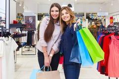 Shot of a beautiful young women going shopping. Shot of a beautiful happy young women with shopping bags Stock Images