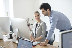 Young business people in the office Royalty Free Stock Photo