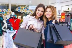 Shot of a beautiful young women going shopping. Shot of a beautiful happy young women with shopping bags Royalty Free Stock Image
